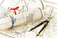 Old Maps in rolls with ribbons and compass Royalty Free Stock Images