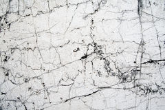Old marble. Old, white marble wall with numerous cracks royalty free stock image