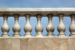 Old marble balustrade. Against blue sky Stock Image