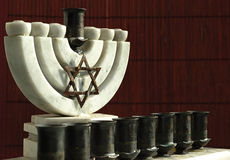 Old marble Hanukiah. The Hanukkah Menorah is a nine-branched candelabrum lit during the eight-day holiday of Hanukkah royalty free stock images