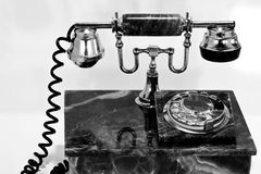 An old marble telephone. A black and white shot of an old marble telephone Royalty Free Stock Images
