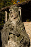 Old maria statue. Very old madonna statue on sun Royalty Free Stock Image
