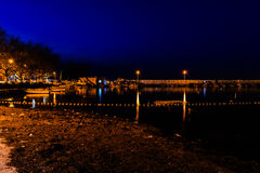 Old Marina At Night. Old marina of Cinarcik town that hosts small boats, fishing vessels and several different type of boats for personal and travel use. Area Stock Photos