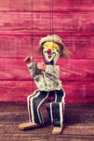 Old marionette on a wooden surface Royalty Free Stock Images