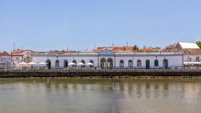 Old Market Hall, Tavira, Portugal. The Old Market Hall or Mercado da Ribeira standing on the e of the Gilao River in the picturesque and historic town of Tavira stock image