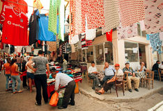 Old market and many seniors sitting and talking at street cafe of turkish village Royalty Free Stock Photography