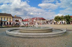 Old market square and fountain in Lowicz, Poland. LOWICZ, Poland .Old market square and fountain in Lowicz Royalty Free Stock Image