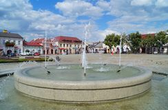 Old market square and fountain in Lowicz, Poland. LOWICZ, Poland .Old market square and fountain in Lowicz Stock Photography