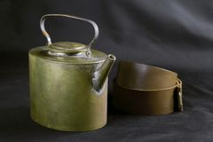Old teapot and leather belt Royalty Free Stock Photography
