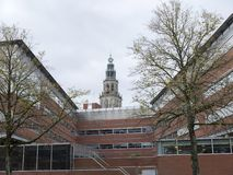 Old martini tower in groningen above modern offices of province Stock Photography