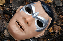 Old mask of Batman. Lies on the ground stock images