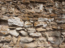 Old masonry. From grey stone closeup for background or textures stock photography
