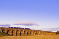 Old masonry arched viaduct carrying a train Royalty Free Stock Photography