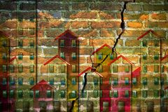 Old masonry buildings which need of a seismic improvement - conc. Ept image with buildings against a cracked brick wall Stock Images