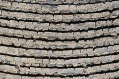 Old masonry wall background. Sagged and bent layers of bricks Royalty Free Stock Photos