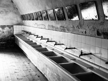 Old mass bathroom in prison Royalty Free Stock Photos