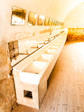 Old mass bathroom in prison Stock Photos