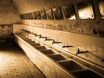 Old mass bathroom in prison Royalty Free Stock Photo