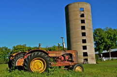 Old Massey Harris tractor and silo Stock Image