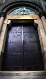 Old massive church door Stock Images