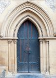 Old massive church door of the catholic church Stock Images