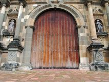 Old massive door of Cathedral. Old massive door of the Metropolitan Cathedral in Casco Viejo, Panama City, Panama Royalty Free Stock Image