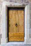 Old massive wooden door. Antique wooden door, made of massive blanks, connected by black rivets, France, Provence stock images