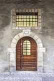 Old massive wooden door with railing Royalty Free Stock Image