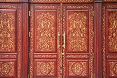 Old, massive, wooden doors. With patterns and large door handles in the Uzbek style Stock Images