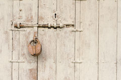 Old master key with steel door Royalty Free Stock Photos
