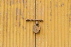 Old master key with steel door Stock Photo
