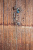 Old master key on wood door Stock Photos