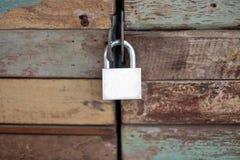 Old master key on the wood door Stock Photo