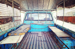 Old mattress place behind back of blue pickup truck in vintage r Royalty Free Stock Photo