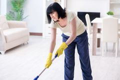 The old mature woman tired after house chores. Old mature woman tired after house chores Stock Photography