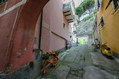 Old means of transport. Of the old means of transport parked in a very colorful Ligurian alley stock photo