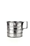 Old Measuring  cup. Old, dented metal measuring cup Royalty Free Stock Photo