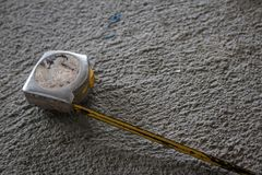 Old Measuring Tape on Cement floor stock images