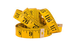 Old Measuring Tape. Old yellow and black measuring tape stock images
