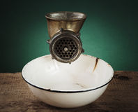 Free Old Meat Grinder And A White Enamel Bowl Royalty Free Stock Photo - 54108535