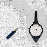 Old mechanical curvimeter over a map. Stock Photo