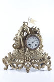 Old mechanical fireplace clock with the knight Stock Images