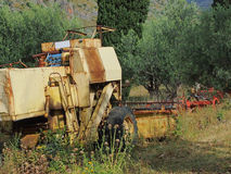 Old Mechanical Harvester. Old mechanical crop harvester in olive grove, Greece Stock Images