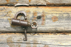 Old mechanical lock and wooden wall Stock Image