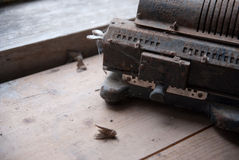 Old mechanical manual counting machine. Royalty Free Stock Images