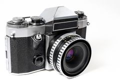 Old mechanical SLR. The reliable assistant during a digital epoch-insurance in difficult  weather conditions Royalty Free Stock Photos