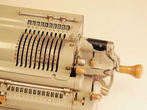 Old mechanical table top calculator with sliders and hand crank. Many Zeros in the display of an old mechanical table top calculator with sliders and hand crank Royalty Free Stock Photo
