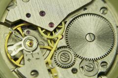 Old mechanical watch mechanism close up. Clock inside gears background, vintage technology Stock Photos