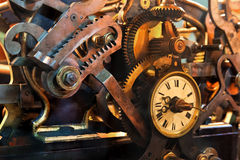 Old mechanism of a big tower clock. Detail of the gears of a very big clock Royalty Free Stock Images