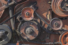 The old mechanism with chain and belt drives Royalty Free Stock Photography